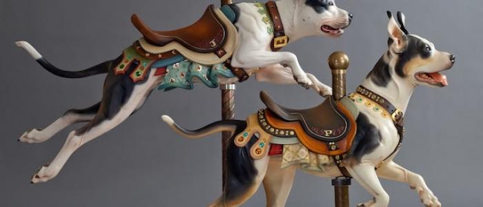 Pitbull statues that look like a carousel ride